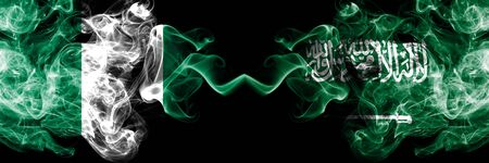 Nigeria vs Saudi Arabia, Arabian abstract smoky mystic flags placed side by side. Thick colored silky smoke flags of Nigerian and Saudi Arabia, Arabian Banco de Imagens - 130621803