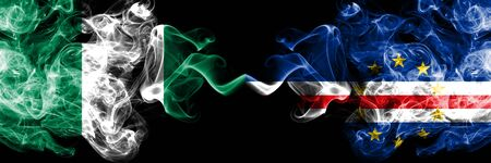 Nigeria vs Cape Verde abstract smoky mystic flags placed side by side. Thick colored silky smoke flags of Nigerian and Cape Verde Banco de Imagens - 130621806