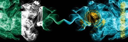 Nigeria vs Kazakhstan, Kazakhstani abstract smoky mystic flags placed side by side. Thick colored silky smoke flags of Nigerian and Kazakhstan, Kazakhstani Banco de Imagens - 130621722