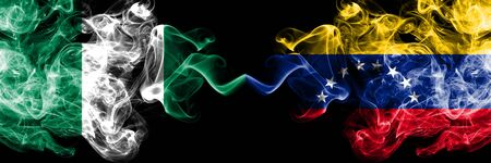 Nigeria vs Venezuela, Venezuelan abstract smoky mystic flags placed side by side. Thick colored silky smoke flags of Nigerian and Venezuela, Venezuelan Banco de Imagens - 130621724