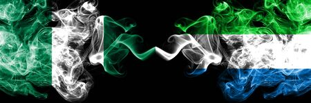 Nigeria vs Sierra Leone abstract smoky mystic flags placed side by side. Thick colored silky smoke flags of Nigerian and Sierra Leone Banco de Imagens
