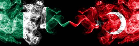 Nigeria vs Turkey, Turkish abstract smoky mystic flags placed side by side. Thick colored silky smoke flags of Nigerian and Turkey, Turkish Banco de Imagens - 130621727