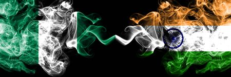 Nigeria vs India, Indian abstract smoky mystic flags placed side by side. Thick colored silky smoke flags of Nigerian and India, Indian