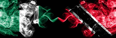 Nigeria vs Trinidad and Tobago abstract smoky mystic flags placed side by side. Thick colored silky smoke flags of Nigerian and Trinidad and Tobago Banco de Imagens - 130621778