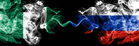 Nigeria vs Russia, Russian abstract smoky mystic flags placed side by side. Thick colored silky smoke flags of Nigerian and Russia, Russian Banco de Imagens