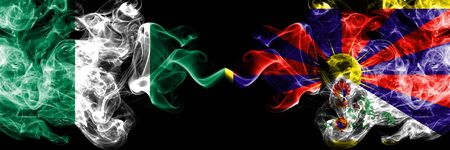 Nigeria vs Tibet, Tibetan abstract smoky mystic flags placed side by side. Thick colored silky smoke flags of Nigerian and Tibet, Tibetan