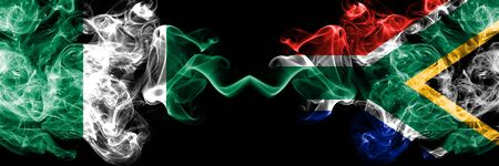 Nigeria vs South Africa, African abstract smoky mystic flags placed side by side. Thick colored silky smoke flags of Nigerian and South Africa, African