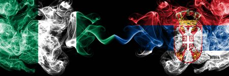 Nigeria vs Serbia, Serbian abstract smoky mystic flags placed side by side. Thick colored silky smoke flags of Nigerian and Serbia, Serbian