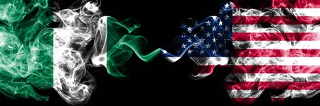 Nigeria vs United States of America, American abstract smoky mystic flags placed side by side. Thick colored silky smoke flags of Nigerian and United States of America, American Banco de Imagens - 130621626