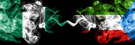 Nigeria vs Equatorial Guinea abstract smoky mystic flags placed side by side. Thick colored silky smoke flags of Nigerian and Equatorial Guinea Banco de Imagens