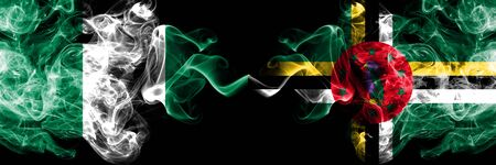 Nigeria vs Dominica abstract smoky mystic flags placed side by side. Thick colored silky smoke flags of Nigerian and Dominica Banco de Imagens - 130621648