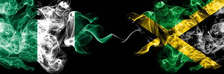 Nigeria vs Jamaica, Jamaican abstract smoky mystic flags placed side by side. Thick colored silky smoke flags of Nigerian and Jamaica, Jamaican