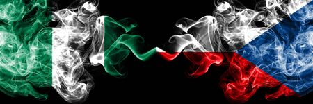 Nigeria vs Czech Republic abstract smoky mystic flags placed side by side. Thick colored silky smoke flags of Nigerian and Czech Republic Banco de Imagens - 130621554