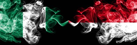 Nigeria vs Monaco, Monacan abstract smoky mystic flags placed side by side. Thick colored silky smoke flags of Nigerian and Monaco, Monacan