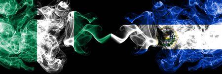 Nigeria vs El Salvador, Salvadorian abstract smoky mystic flags placed side by side. Thick colored silky smoke flags of Nigerian and El Salvador, Salvadorian Banco de Imagens