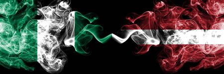 Nigeria vs Latvia, Latvian abstract smoky mystic flags placed side by side. Thick colored silky smoke flags of Nigerian and Latvia, Latvian