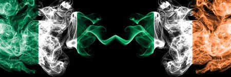 Nigeria vs Ireland, Irish abstract smoky mystic flags placed side by side. Thick colored silky smoke flags of Nigerian and Ireland, Irish Banco de Imagens - 130621542