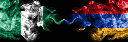 Nigeria vs Armenia, Armenian abstract smoky mystic flags placed side by side. Thick colored silky smoke flags of Nigerian and Armenia, Armenian Banco de Imagens - 130621544