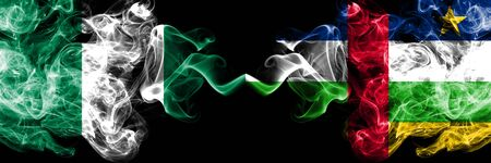 Nigeria vs Central African Republic abstract smoky mystic flags placed side by side. Thick colored silky smoke flags of Nigerian and Central African Republic Banco de Imagens - 130621545