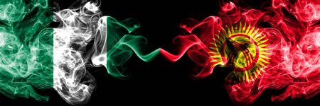 Nigeria vs Kyrgyzstan abstract smoky mystic flags placed side by side. Thick colored silky smoke flags of Nigerian and Kyrgyzstan Banco de Imagens - 130621547