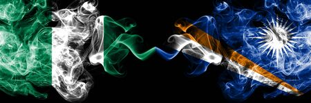 Nigeria vs Marshall Islands abstract smoky mystic flags placed side by side. Thick colored silky smoke flags of Nigerian and Marshall Islands Banco de Imagens