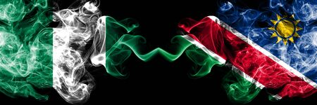 Nigeria vs Namibia, Namibian abstract smoky mystic flags placed side by side. Thick colored silky smoke flags of Nigerian and Namibia, Namibian