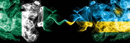 Nigeria vs Rwanda, Rwandan abstract smoky mystic flags placed side by side. Thick colored silky smoke flags of Nigerian and Rwanda, Rwandan Banco de Imagens - 130621488