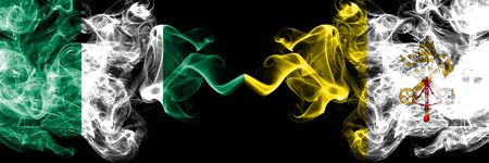 Nigeria vs Vatican city abstract smoky mystic flags placed side by side. Thick colored silky smoke flags of Nigerian and Vatican city Banco de Imagens