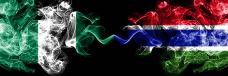 Nigeria vs Gambia, Gambian abstract smoky mystic flags placed side by side. Thick colored silky smoke flags of Nigerian and Gambia, Gambian
