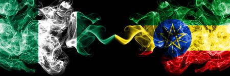 Nigeria vs Ethiopia, Ethiopian abstract smoky mystic flags placed side by side. Thick colored silky smoke flags of Nigerian and Ethiopia, Ethiopian Banco de Imagens - 130621497