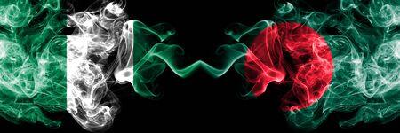 Nigeria vs Bangladesh, Bangladeshi abstract smoky mystic flags placed side by side. Thick colored silky smoke flags of Nigerian and Bangladesh, Bangladeshi Banco de Imagens - 130621513