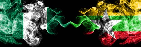 Nigeria vs Myanmar abstract smoky mystic flags placed side by side. Thick colored silky smoke flags of Nigerian and Myanmar