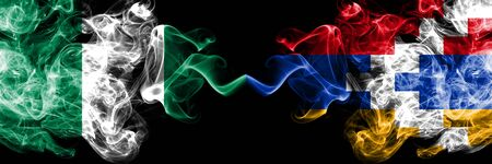 Nigeria vs Artsakh abstract smoky mystic flags placed side by side. Thick colored silky smoke flags of Nigerian and Artsakh
