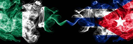Nigeria vs Cuba, Cuban abstract smoky mystic flags placed side by side. Thick colored silky smoke flags of Nigerian and Cuba, Cuban Banco de Imagens