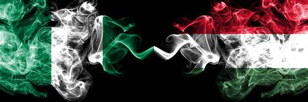 Nigeria vs Hungary, Hungarian abstract smoky mystic flags placed side by side. Thick colored silky smoke flags of Nigerian and Hungary, Hungarian
