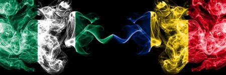 Nigeria vs Romania, Romanian abstract smoky mystic flags placed side by side. Thick colored silky smoke flags of Nigerian and Romania, Romanian Banco de Imagens - 130621449