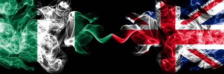 Nigeria vs United Kingdom, British, Great Britain abstract smoky mystic flags placed side by side. Thick colored silky smoke flags of Nigerian and United Kingdom, British, Great Britain