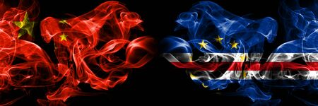 China vs Cape Verde smoke flags placed side by side. Thick colored silky smoke flags of Chinese and Cape Verde
