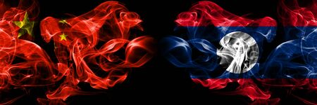 China vs Laos smoke flags placed side by side. Thick colored silky smoke flags of Chinese and Laos 版權商用圖片