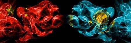 China vs Kazakhstan, Kazakhstani smoke flags placed side by side. Thick colored silky smoke flags of Chinese and Kazakhstan, Kazakhstani 版權商用圖片