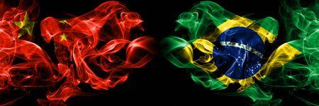 China vs Brazil, Brazilian smoke flags placed side by side. Thick colored silky smoke flags of Chinese and Brazil, Brazilian 版權商用圖片