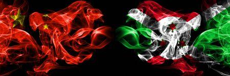 China vs Burundi, Burundian smoke flags placed side by side. Thick colored silky smoke flags of Chinese and Burundi, Burundian