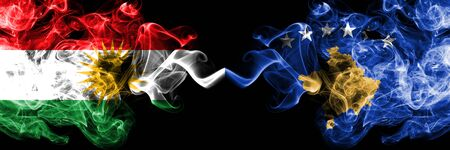 Kurdistan vs Kosovo, Serbia smoke flags placed side by side. Thick colored silky smoke flags of Kurds and Kosovo, Serbia