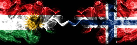 Kurdistan vs Norway, Norwegian smoke flags placed side by side. Thick colored silky smoke flags of Kurds and Norway, Norwegian Reklamní fotografie