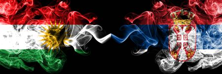 Kurdistan vs Serbia, Serbian smoke flags placed side by side. Thick colored silky smoke flags of Kurds and Serbia, Serbian