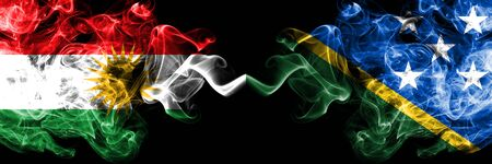 Kurdistan vs Solomon Islands smoke flags placed side by side. Thick colored silky smoke flags of Kurds and Solomon Islands