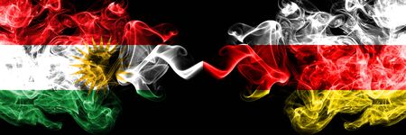 Kurdistan vs South Ossetia smoke flags placed side by side. Thick colored silky smoke flags of Kurds and South Ossetia