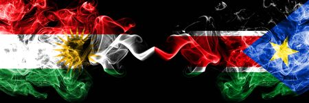 Kurdistan vs South Sudan smoke flags placed side by side. Thick colored silky smoke flags of Kurds and South Sudan