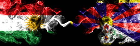Kurdistan vs Tibet, Tibetan smoke flags placed side by side. Thick colored silky smoke flags of Kurds and Tibet, Tibetan