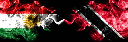 Kurdistan vs Trinidad and Tobago smoke flags placed side by side. Thick colored silky smoke flags of Kurds and Trinidad and Tobago 版權商用圖片